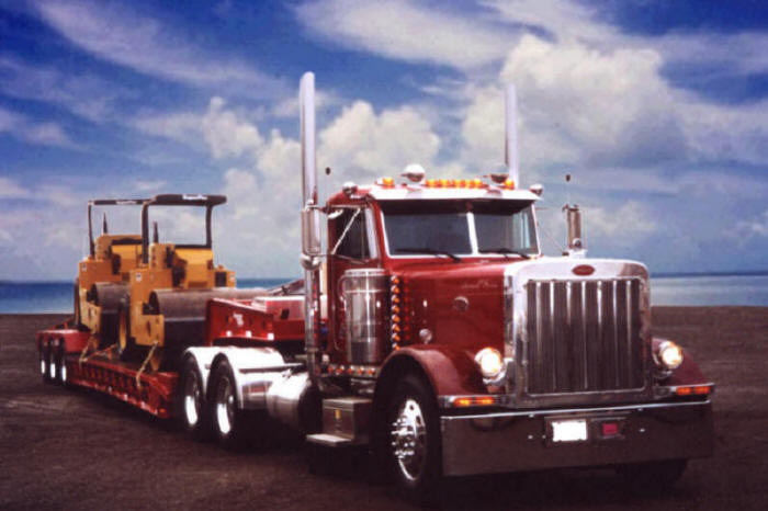 Peterbilt heavy equipment hauler with lowboy trailer