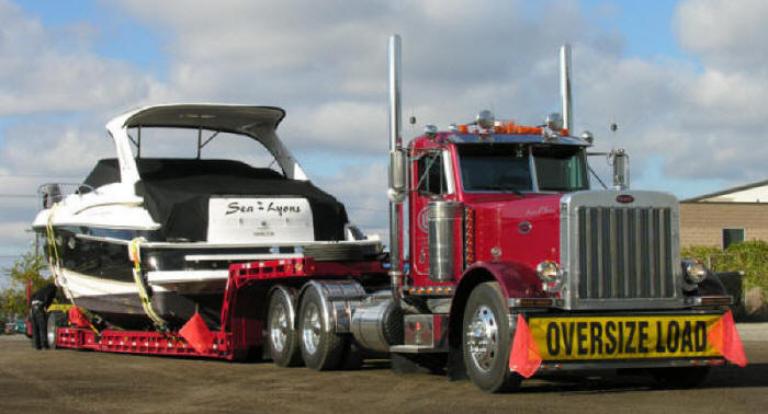 oversize load, wide and over dimentional cargo load on trombone trailer boat hauler
