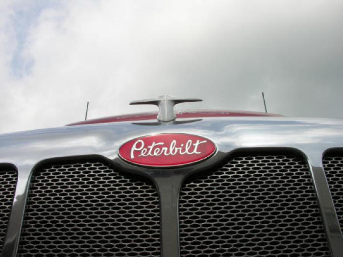 Peterbilt hood ornament and logo plate onbstainless steel grill